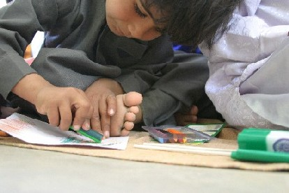 Boy Coloring in Dhordo